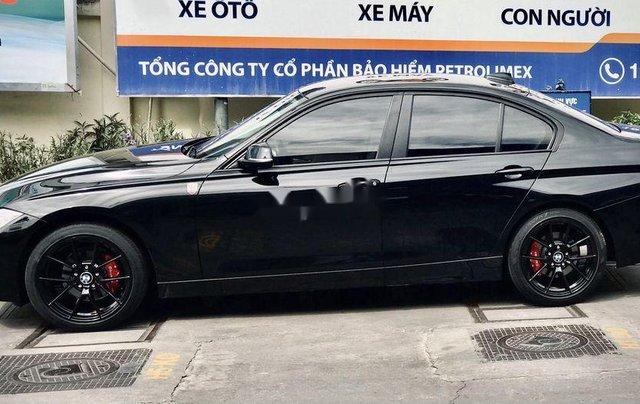 Bán xe BMW 320i 2013, màu đen, giá tốt1