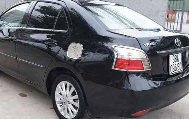 Cần bán Toyota Vios sản xuất năm 2011, màu đen0