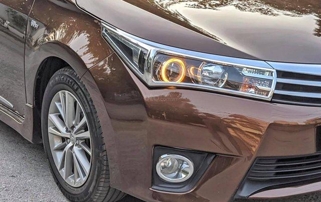 Cần bán nhanh chiếc Toyota Corolla Altis sản xuất năm 2014, màu nâu4