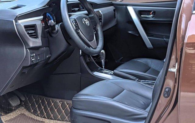 Cần bán nhanh chiếc Toyota Corolla Altis sản xuất năm 2014, màu nâu8
