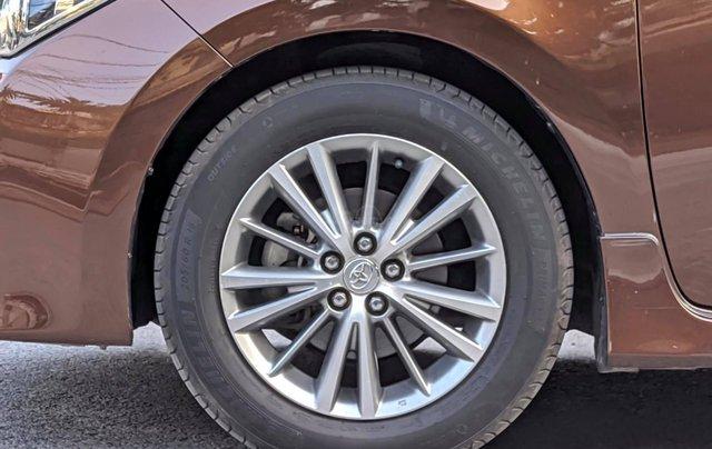 Cần bán nhanh chiếc Toyota Corolla Altis sản xuất năm 2014, màu nâu5