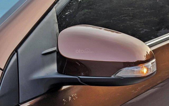 Cần bán nhanh chiếc Toyota Corolla Altis sản xuất năm 2014, màu nâu9