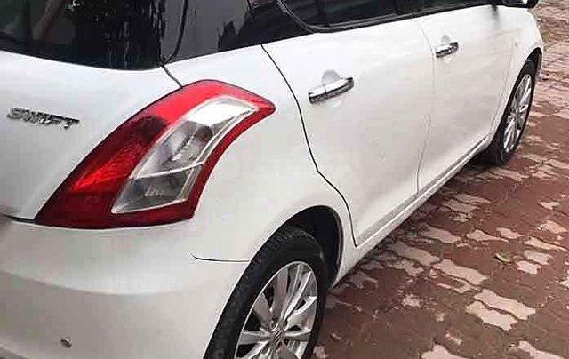 Cần bán Suzuki Swift đời 2017, màu trắng số tự động1