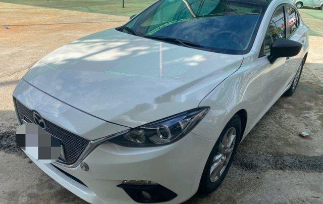 Cần bán Mazda 3 đời 2015, màu trắng còn mới0