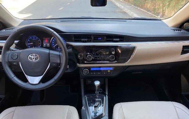Cần bán xe Toyota Corolla Altis đời 2016, màu bạc2