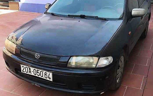 Bán ô tô Mazda 323 năm sản xuất 1998, màu đen, 65tr0