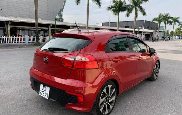 Cần bán xe Kia Rio 1.4AT SX 2015, màu đỏ0
