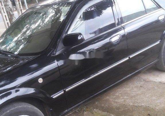Cần bán Ford Laser 2004, màu đen chính chủ3