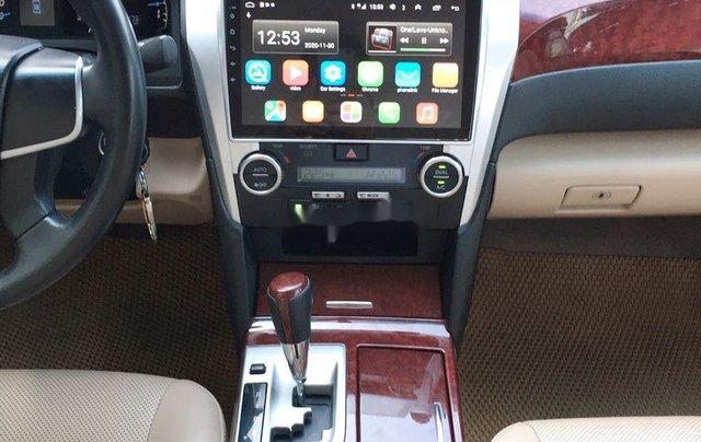 Cần bán xe Toyota Camry 2014, màu đen chính chủ, 668 triệu8