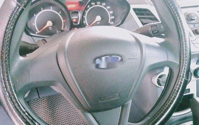 Cần bán xe Ford Fiesta 2011, màu đen xe gia đình4