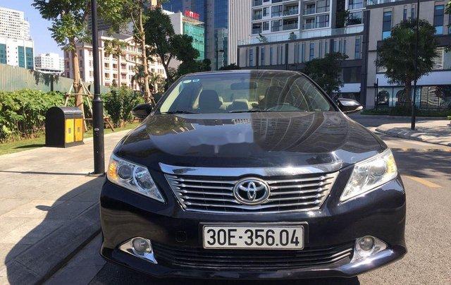 Cần bán xe Toyota Camry 2014, màu đen chính chủ, 668 triệu0