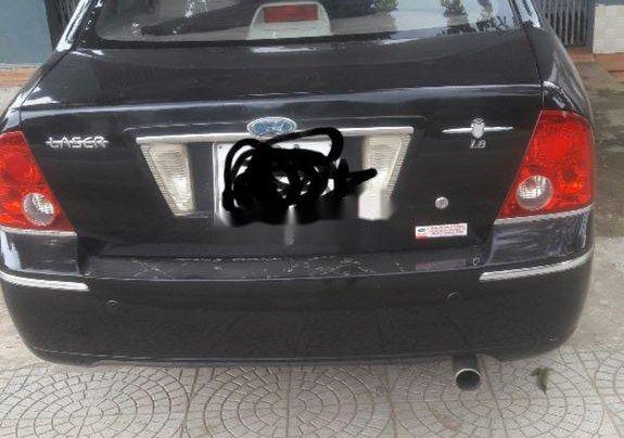 Cần bán Ford Laser 2004, màu đen chính chủ1