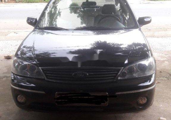 Cần bán Ford Laser 2004, màu đen chính chủ0