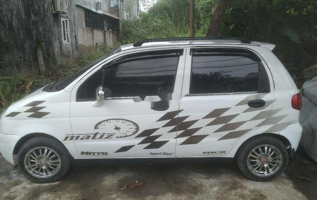 Cần bán gấp Daewoo Matiz đời 2003, màu trắng, nhập khẩu còn mới, giá chỉ 62 triệu0