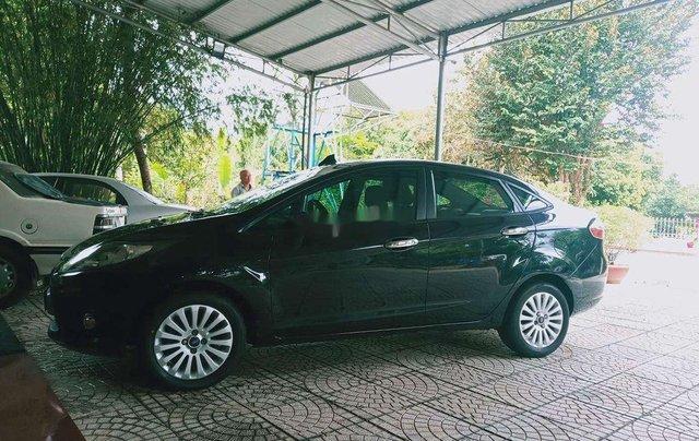 Cần bán xe Ford Fiesta 2011, màu đen xe gia đình2