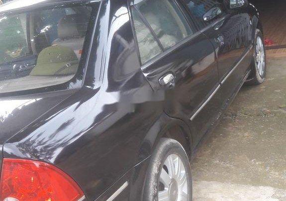 Cần bán Ford Laser 2004, màu đen chính chủ2