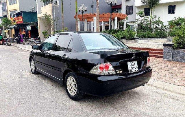 Bán Mitsubishi Lancer sản xuất 2005, màu đen còn mới3