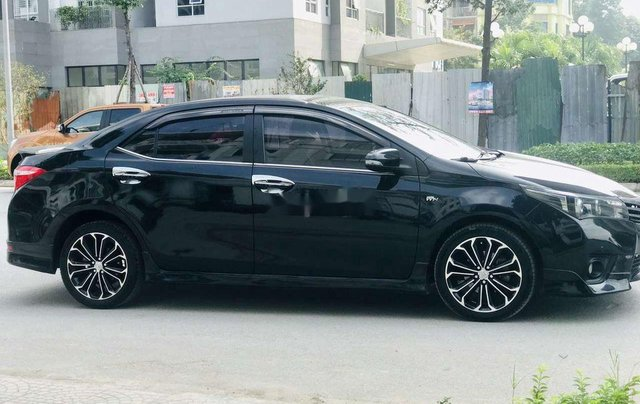 Cần bán gấp Toyota Corolla Altis đời 2014, màu đen còn mới4
