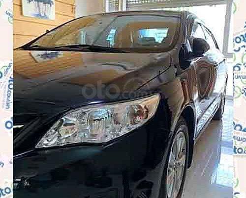 Cần bán Toyota Corolla Altis sản xuất năm 2013, màu đen như mới, 545 triệu4