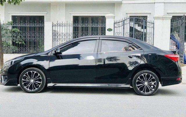Cần bán gấp Toyota Corolla Altis đời 2014, màu đen còn mới3