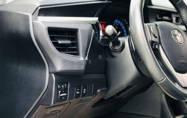 Cần bán gấp Toyota Corolla Altis đời 2014, màu đen còn mới8