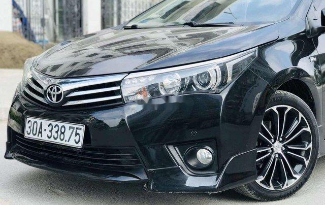 Cần bán gấp Toyota Corolla Altis đời 2014, màu đen còn mới5