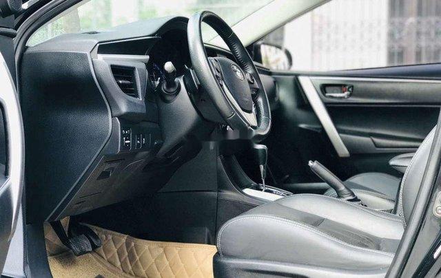 Cần bán gấp Toyota Corolla Altis đời 2014, màu đen còn mới9