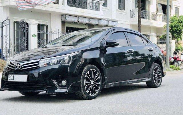 Cần bán gấp Toyota Corolla Altis đời 2014, màu đen còn mới1