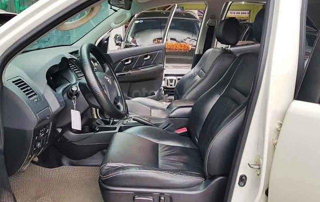 Bán Toyota Fortuner năm 2014, màu trắng, 635 triệu3