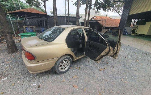 Cần bán lại xe Mazda 323 đời 1999, màu vàng0