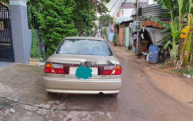 Cần bán lại xe Mazda 323 đời 1999, màu vàng7
