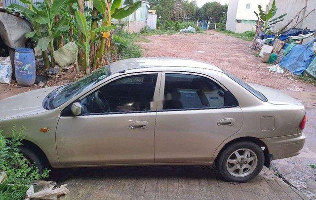 Cần bán lại xe Mazda 323 đời 1999, màu vàng9