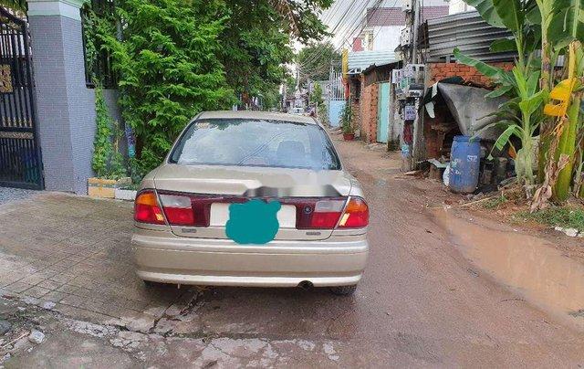 Cần bán lại xe Mazda 323 đời 1999, màu vàng8