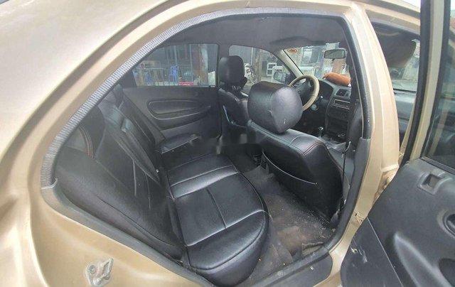 Cần bán lại xe Mazda 323 đời 1999, màu vàng2