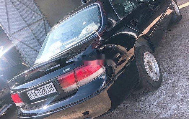 Bán Mazda 626 sản xuất năm 1999, màu đen, nhập khẩu, giá 135tr3