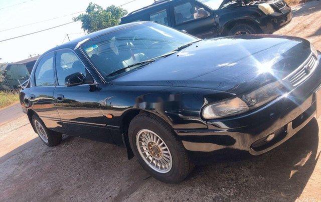 Bán Mazda 626 sản xuất năm 1999, màu đen, nhập khẩu, giá 135tr1