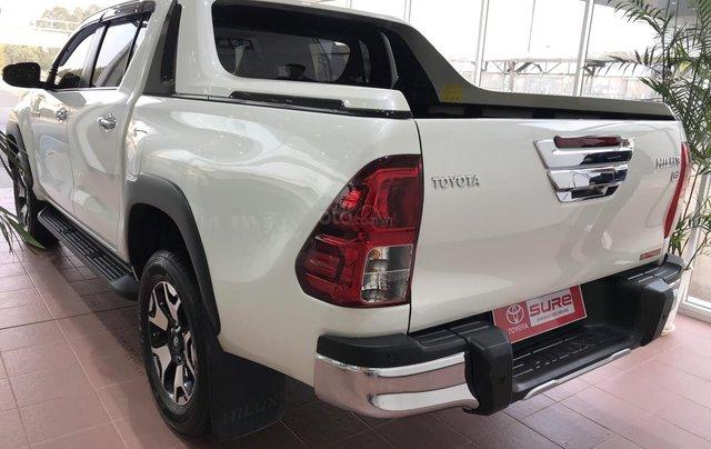 Cần bán xe Toyota Hilux AT 2019 màu trắng, biển Hà Nội, xe gia đình, xe mới chạy hơn 43.000 km - xe cũ chính hãng giá tốt2