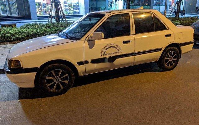 Cần bán gấp Mazda 323 đời 1995, màu trắng, nhập khẩu5