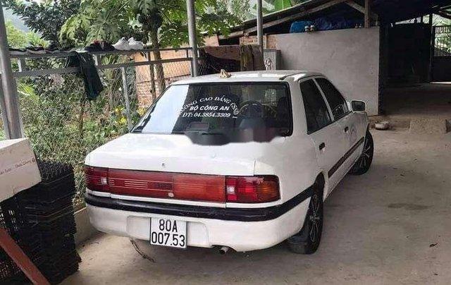 Cần bán gấp Mazda 323 đời 1995, màu trắng, nhập khẩu0