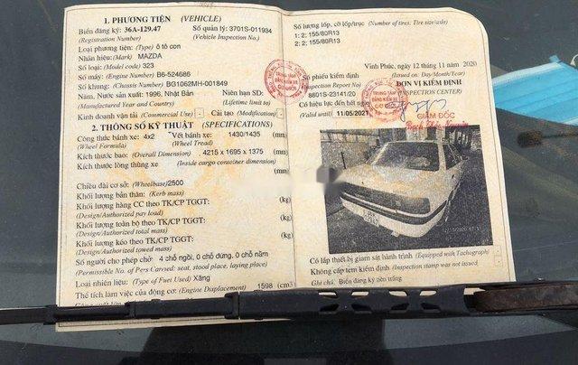 Cần bán xe Mazda 323 sản xuất năm 1997, xe nhập còn mới9