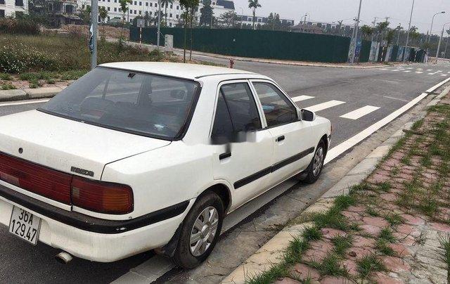 Cần bán xe Mazda 323 sản xuất năm 1997, xe nhập còn mới10