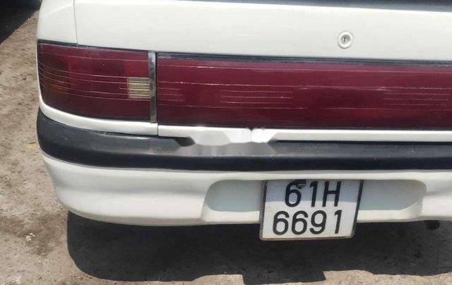 Cần bán xe Mazda 323 năm sản xuất 1995, màu trắng, nhập khẩu2