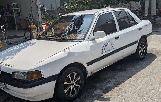 Cần bán lại xe Mazda 323 sản xuất 1994, màu trắng, nhập khẩu nguyên chiếc0