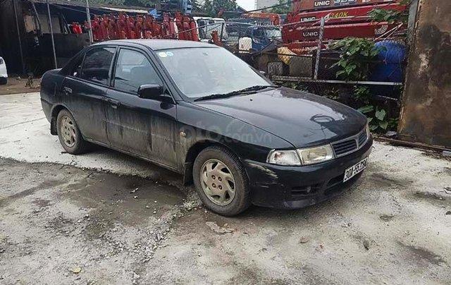 Cần bán gấp Mitsubishi Lancer đời 2001, màu đen 0