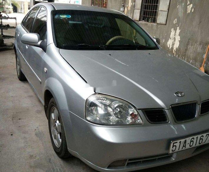 Bán ô tô Daewoo Lacetti năm sản xuất 2004, màu bạc0