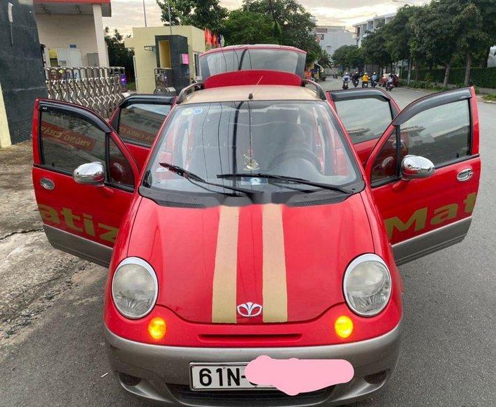 Cần bán xe Daewoo Matiz sản xuất năm 2006, màu đỏ số sàn, giá tốt0