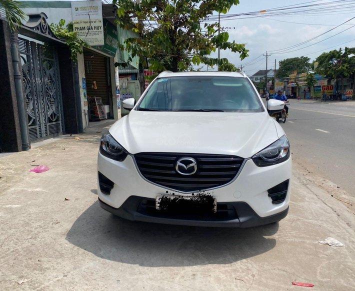 Cần bán xe Mazda CX 5 đăng ký 2016, màu trắng ít sử dụng, giá tốt 708 triệu đồng0