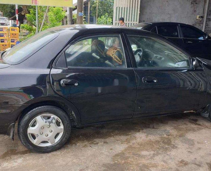 Bán Mazda 323 đời 2000, màu đen0