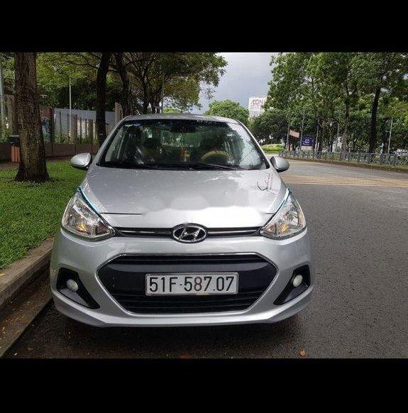 Cần bán lại xe Hyundai Grand i10 đời 2015, màu bạc số sàn0