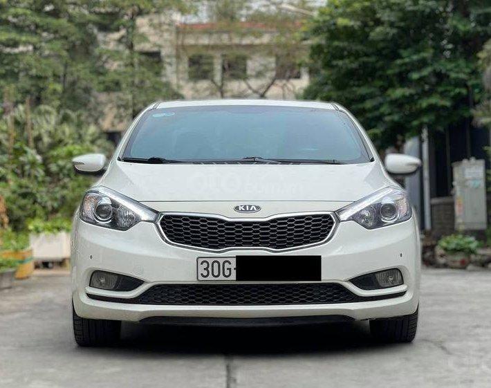Cần bán lại xe Kia K3 2014, màu trắng, số tự động0